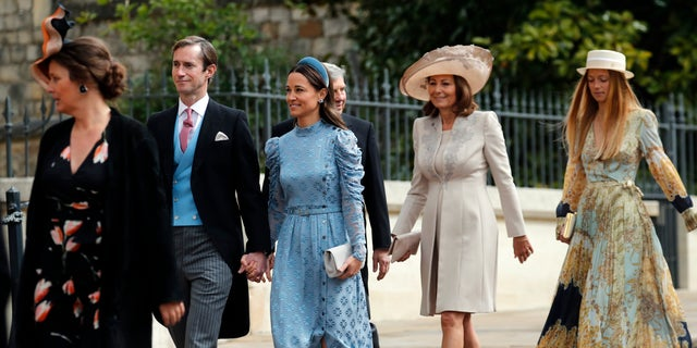 James Matthews, second left, and his wife Pippa, third left, arrive for the wedding of Lady Gabriella Windsor and Thomas Kingston at St George's Chapel, Windsor Castle, near London, England, Saturday, May 18, 2019. (AP Photo/Frank Augstein, Pool)