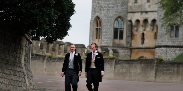 Thomas Kingston, right, arrives for his wedding to Lady Gabriella Windsor at St George's Chapel, Windsor Castle, near London, England, Saturday, May 18, 2019. (AP Photo/Frank Augstein, Pool)