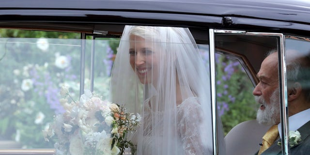 Lady Gabriella Windsor arrives in her car for her wedding to Thomas Kingston, with her father Prince Michael of Kent at St George's Chapel, Windsor Castle, near London, England, Saturday, May 18, 2019. (Chris Jackson/Pool via AP)