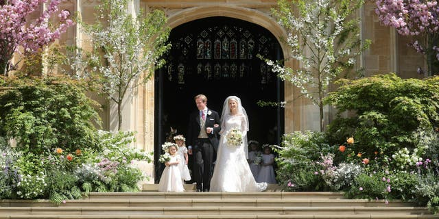 Newlyweds Thomas Kingston and Lady Gabriella Windsor on the steps of the chapel after their wedding at St George's Chapel, Windsor Castle, near London, England, Saturday, May 18, 2019. (Chris Jackson/Pool via AP)