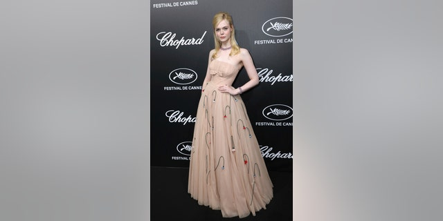 Actress Elle Fanning poses for photographers upon arrival at the Chopard Trophee event at the 72nd international film festival, Cannes, southern France, Monday, May 20, 2019.