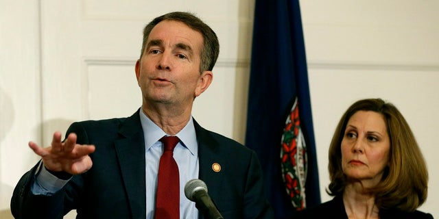 Virginia Gov. Ralph Northam, left, gestures as his wife, Pam, listens during a Feb. 2 news conference in the Governors Mansion at the Capitol in Richmond, Va.