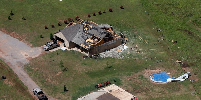 A house damaged in a tornado Monday in Mangum, Oklahoma. (AP Photo/Sue Ogrocki)