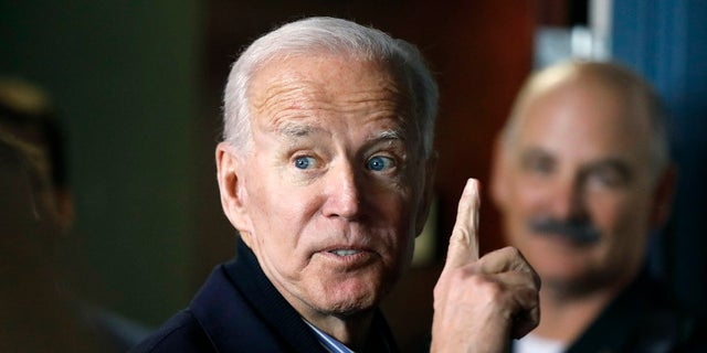 In this May 13, 2019, photo, former vice president and Democratic presidential candidate Joe Biden interacts with a supporter during a campaign stop at the Community Oven restaurant in Hampton, N.H. (AP Photo/Michael Dwyer, File)