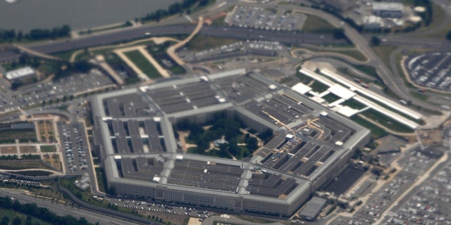 In this June 3, 2011, file photo, the Pentagon is seen from air from Air Force One. Nearly two dozen progressive groups are launching a new push to persuade Democratic presidential candidates to support dramatic spending cuts at the Pentagon. (AP Photo/Charles Dharapak, File)