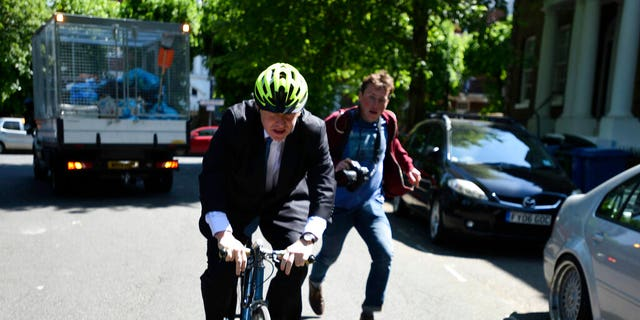 Politician Boris Johnson leaves his home, on the day of the European Parliament elections, in London, Thursday May 23, 2019.