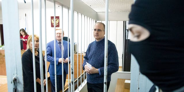 Paul Whelan, a former U.S. Marine, center, who was arrested in Moscow at the end of last year, waits for a hearing in a court in Moscow, Russia, Friday, May 24, 2019. The American was detained at the end of December for alleged spying.