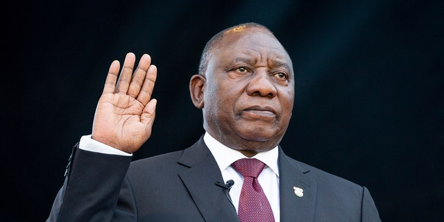 South African President Cyril Ramaphosa, right, takes the Oath of Office at the Loftus Versfeld Stadium in Pretoria, South Africa. (Yeshiel Panchia/Pool Photo via AP)