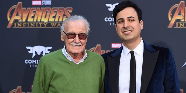"In this April 23, 2018, file photo, Stan Lee, left, and Keya Morgan arrive at the world premiere of ""Avengers: Infinity War"" in Los Angeles. Morgan, the former business manager of Lee has been arrested on elder abuse charges involving the late comic book icon. (Photo by Jordan Strauss/Invision/AP, File)"