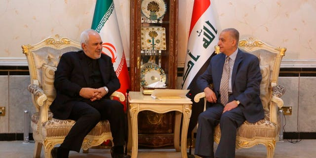 Iraqi Foreign Minister Mohamed Alhahkim, right, meets with his visiting Iranian counterpart Mohammad Javad Zarif at the Ministry of Foreign Affairs in Baghdad.