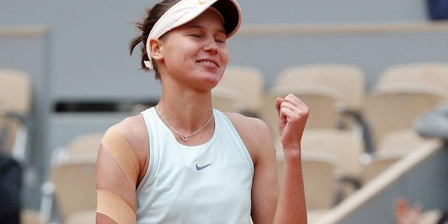 Russia's Veronika Kudermetova celebrates winning against Denmark's Caroline Wozniacki in three sets, 0-6, 6-3, 6-3, during their first round match of the French Open tennis tournament at the Roland Garros stadium in Paris, Monday, May 27, 2019. (AP Photo/Pavel Golovkin)