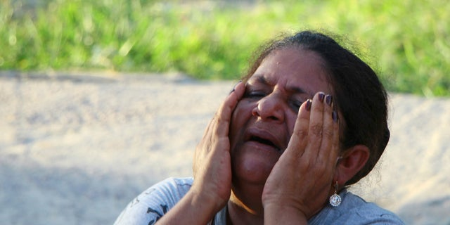 The mother of a prisoner who cries on Monday in front of the Anisio Jobim prison complex in Manaus, Brazil. (AP Photo / Edmar Barros)