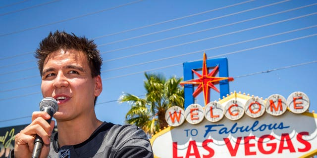 """""""Jeopardy!"""" sensation James Holzhauer speaks after being presented with a key to the Las Vegas Strip in front of the """"Welcome to Fabulous Las Vegas"""" sign in Las Vegas. (Associated Press)"""
