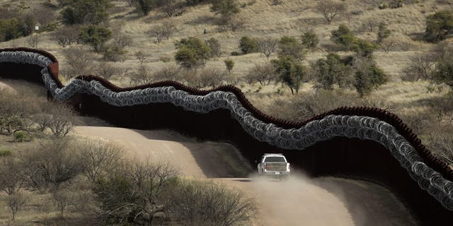Customs and Border Control agent patrols east of Nogales, Ariz. (AP Photo/Charlie Riedel, File)