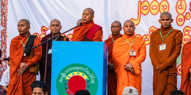 In this May 5, 2019, photo, Buddhist monk and anti-Muslim community leader Wirathu, center, speaks during a nationalist rally in Yangon, Myanmar.