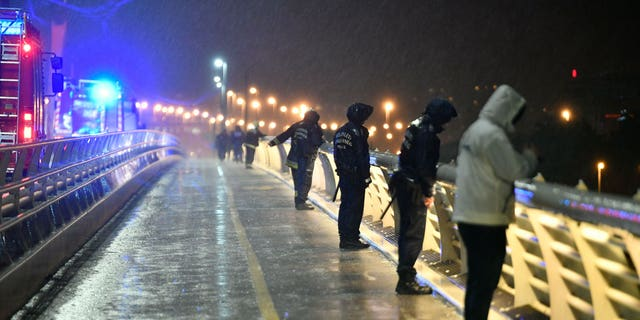 Rescuers and police officers at the scene from a landing dock in Budapest. (Zsolt Szigetvary / MTI via AP)