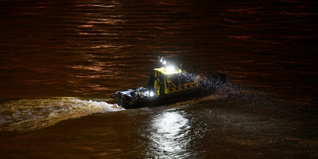 A rescue boat searching for victims Wednesday night. (Zsolt Szigetvary / MTI via AP)