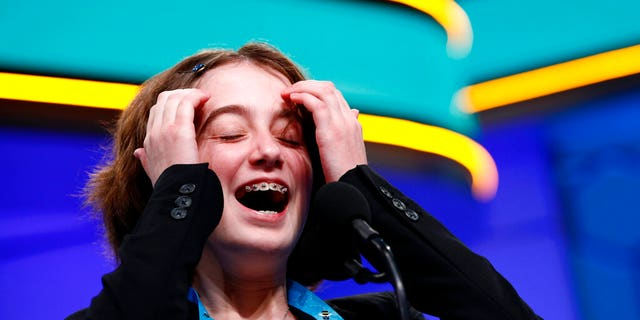 Colette Giezentanner, 12, from St. Louis, laughs as she takes to the finals of Scripps National Spelling Bee on Thursday. May 30, 2019 in Oxon Hill, Md.