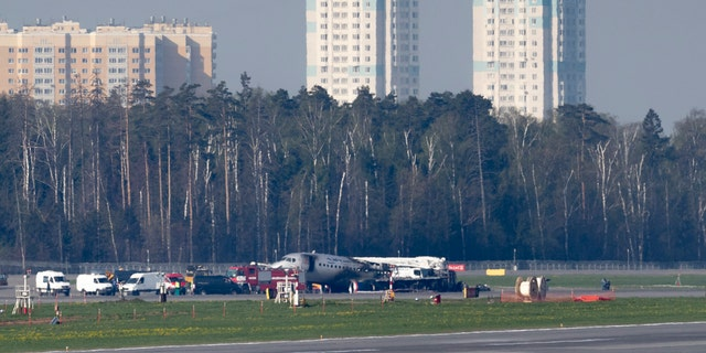 The Sukhoi SSJ100 aircraft of Aeroflot Airlines, center in the background, is seen after an emergency landing in Sheremetyevo airport outside Moscow, Russia, Monday, May 6, 2019.