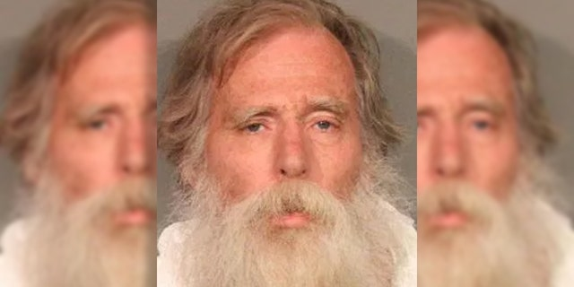 """Anthony Brant Taylor, 64, was arrested in connection with the killing of a woman after he was discovered """"covered in blood"""" lying in the middle of a street, according to officials."""