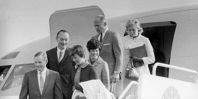 """File photo - The Apollo 11 astronauts and their wives leaving the Presidential aircraft at Heathrow Airport in London during their """"Giant Leap"""" global goodwill tour. Neil Armstrong is accompanied by his wife Janet, who can be seen the lunar brooch on her lapel."""