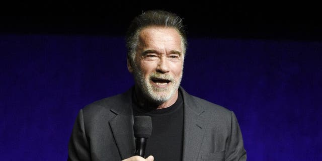 "FILE - In this Thursday, April 4, 2019 file photo, Arnold Schwarzenegger, a cast member in the upcoming film ""Terminator: Dark Fate,"" discusses the film during the Paramount Pictures presentation at CinemaCon 2019, the official convention of the National Association of Theatre Owners (NATO) at Caesars Palace, in Las Vegas.(Photo by Chris Pizzello/Invision/AP, File)"
