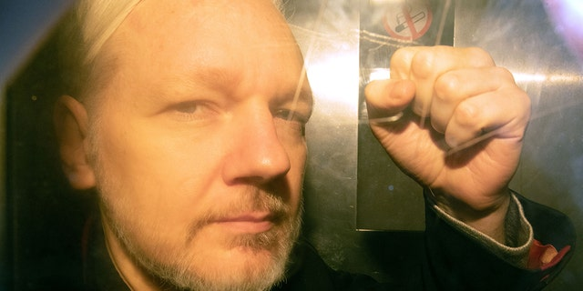 WikiLeaks founder Julian Assange arrives at court in London on May 1, 2019 to be sentenced for bail violation.