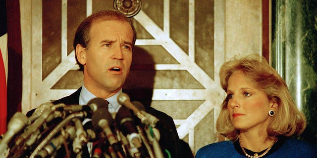 Sen. Joseph Biden Jr., D-Del., holds a news conference in Washington on Sept. 23, 1987, to announce he is withdrawing from the Democratic race for the presidential nomination. Biden's wife, Jill, listens to the announcement. (AP Photo/Ron Edmonds)