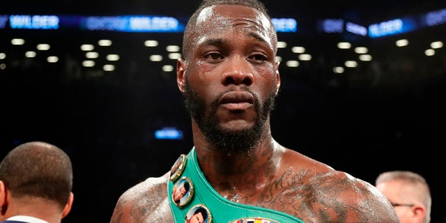 FILE - In this March 3, 2018, file photo, Deontay Wilder poses for photographs after the WBC heavyweight champion defeated Luis Ortiz in New York. (AP Photo/Frank Franklin II, File)