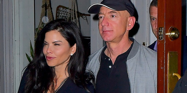 Jeff Bezos and Lauren Sanchez are seen together in NYC after having dinner together.