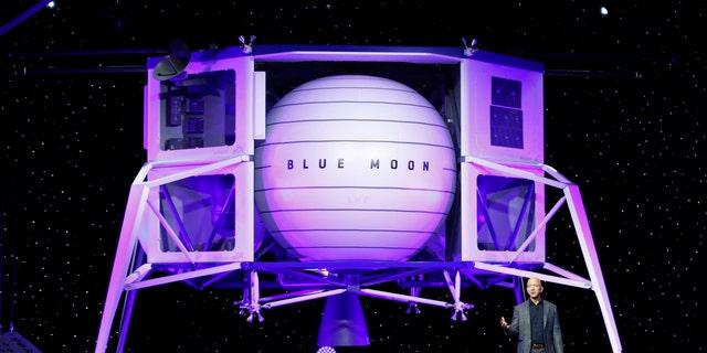 Jeff Bezos speaks in front of a model of Blue Origin's Blue Moon lunar lander, Thursday, May 9, 2019, in Washington D.C.. (AP Photo/Patrick Semansky)