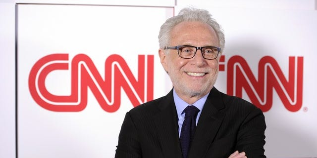 CNN anchor Wolf Blitzer helped delay Iowa Caucus results when distracted precinct captain stayed on the phone with him instead of reporting results.