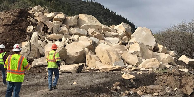 Rubble can be seen after a massive boulder was blasted into pieces after destroying a section of a highway in Colorado over the weekend.