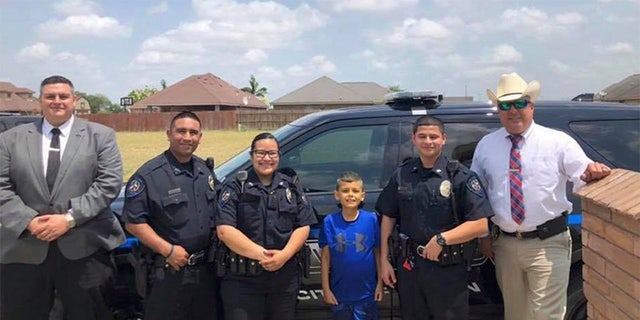 Officers visit with Brandon Tadeo Alvarez, a 9-year-old battling cancer.