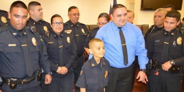 Police officers and community members created a board of supportive messages for Brandon Tadeo Alvarez, who was sworn in as an honorary police captain on Friday.