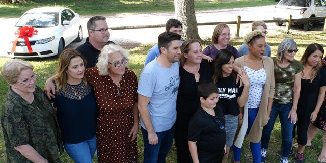 Celeste Bokstrom, a single mom helped out by Burly Man Coffee, was surprised with a brand new car surrounded by family and friends in March.