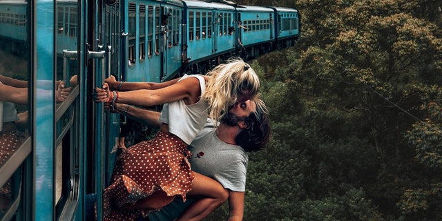 Influencers Jean and Camille, of the BackpackDiariez Instagram handle, were photographed gripping onto the side of a blue train while leaning out for a risky kiss in Sri Lanka.