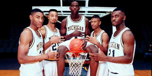 Michigan's Fab Five, from left, Jimmy King, Juwan Howard, Chris Webber, Jalen Rose and Ray Jackson poise in Ann Arbor, Mich. (AP Photo, File)