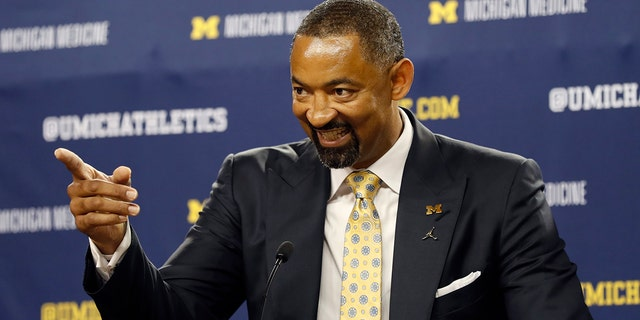 Juwan Howard smiles during his introduction as Michigan's new men's basketball coach, Thursday, May 30, 2019 in Ann Arbor, Mich. (AP Photo/Carlos Osorio)
