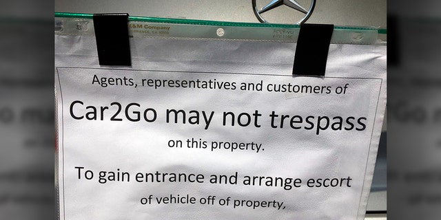 This undated photo provided by KOMO News shows a notice attached to a car-share vehicle parked at a Seattle duplex. (KOMO News via AP)