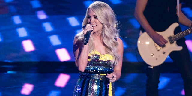 "The ""Before He Cheats"" singer sported a $30,000 custom amethyst ring designed by Kyle Chan for her ""American Idol"" performance on Monday."