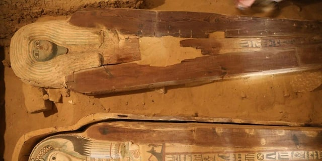 Archaeologists discovered painted and decorated wooden anthropoid coffins at the site.