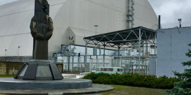 The safe confinement structure surrounding the sarcophagus built around the Chernobyl reactor.