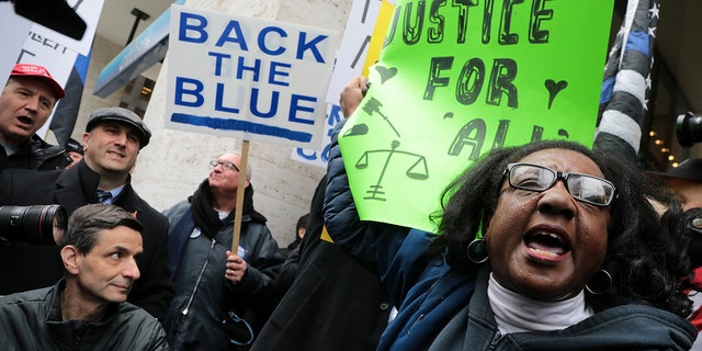 April 1, 2019 - Chicago, Illinois, U.S. - Dueling protests from the Fraternal Order of Police, left, and Chicago Alliance Against Racist and Political Repression, right, take place outside the Cook County Administration Building in response to the ongoing controversy over the Smollett case. (Credit Image: © Antonio Perez/Chicago Tribune/TNS via ZUMA Wire)