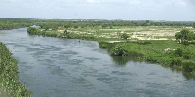 The Rio Grande divides Del Rio, Texas, on the left ant Ciudad Acuna, Mexico, as it flows southeast on July 6, 2002. (Associated Press)