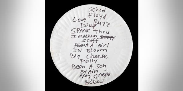 Kurt Cobain reportedly ate pizza off this paper plate in 1990 before he turned it over and wrote this set list on the back in black marker. The plate sold last week for $22,400.