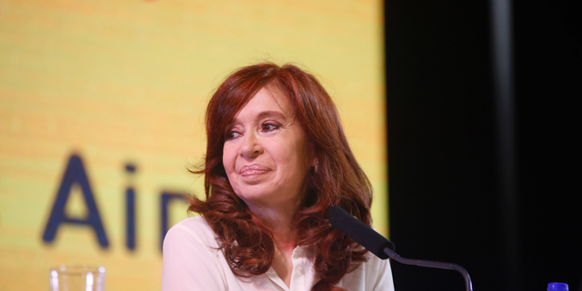 """In this handout photo provided by the Unidad Ciudadana political party, former Argentine President Cristina Fernandez smiles as she officially present her book """"Sincerely,"""" during the Buenos Aires book fair in Argentina, Thursday, May 9, 2019. The presentation of her memoirs has become a best-seller since its release. (Unidad Ciudadana via AP )"""