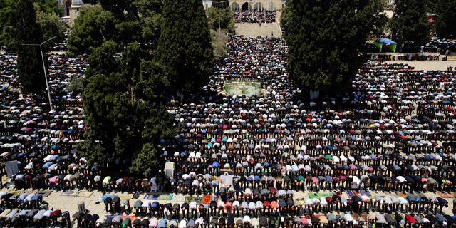 Palestinians pray in front of the Dome of the Rock shrine during a holy month of Ramadan, in Jerusalem, Friday, May 10, 2019. (AP Photo/Mahmoud Illean)