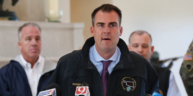 Oklahoma Gov. Kevin Stitt talks with the media following an aerial tour of tornado- and flood-damaged areas of the state, Tuesday, May 21, 2019, in Oklahoma City. (AP Photo/Sue Ogrocki)