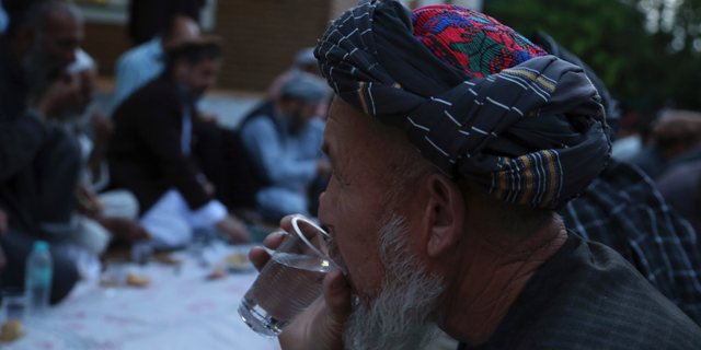 Afghans break their fast during the holy month of Ramadan, in Kabul, Afghanistan, Sunday, May 12, 2019. Muslims throughout the world are celebrating Ramadan, the holiest month in the Islamic calendar, refraining from eating, drinking, smoking and sex from sunrise to sunset. (AP Photo/Rahmat Gul)